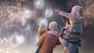 Photo of family watching winter fireworks